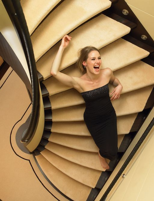 charter guest on staircase inside charter yacht HARLE