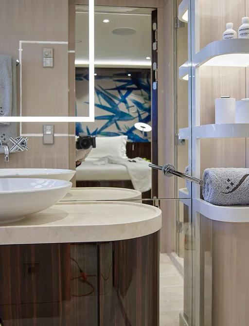 guest en suite on luxury yacht soaring, with mirrored panels and elegant sink