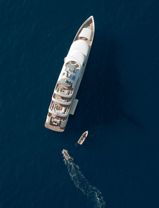 superyacht KIBO anchors on a luxury yacht charter as tenders take to the waters