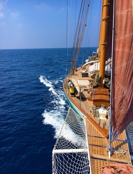 view of deck on board sailing yacht DALLINGHOO as she cuts through the water in South East Asia