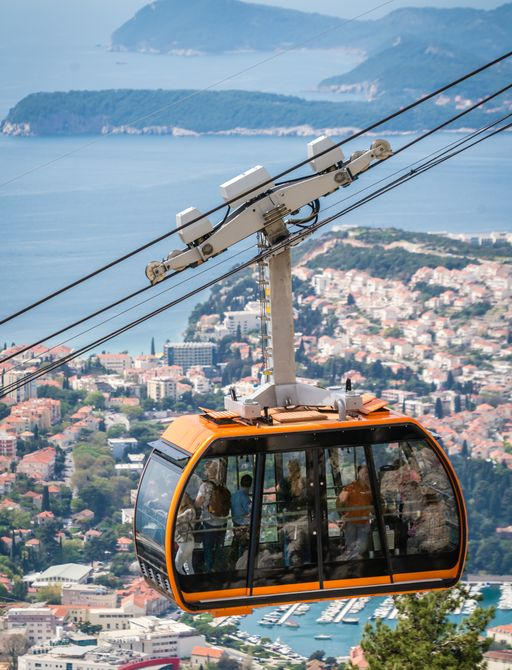 Orange cable cars going up the mountain in Dubrovnik