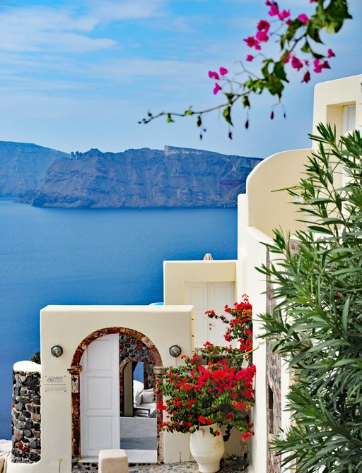 Flower covered walls in Oia, Santorini