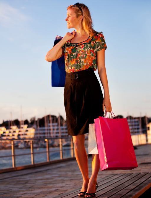 a shopper with bags returns to superyacht after a day of shopping in Cannes