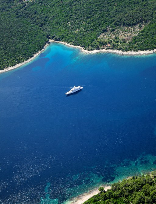 A lone yacht anchored in blue waters of Croatia