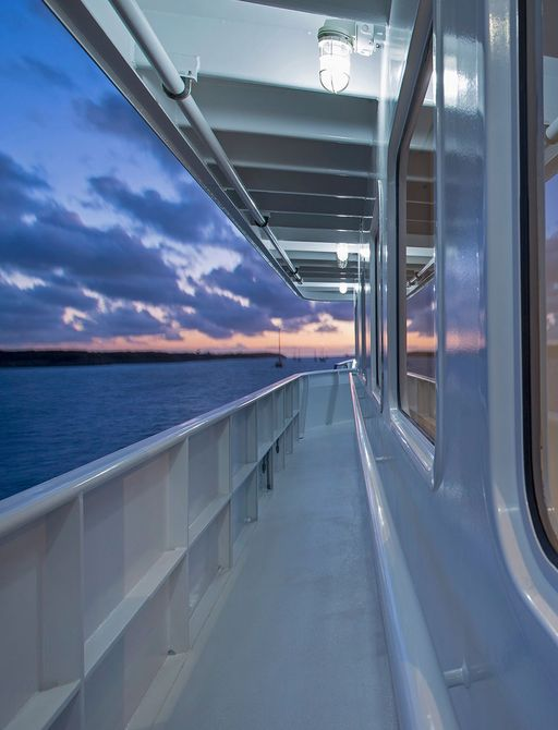 View along side of explorer yacht MARCATO, with view into Sky Lounge through window