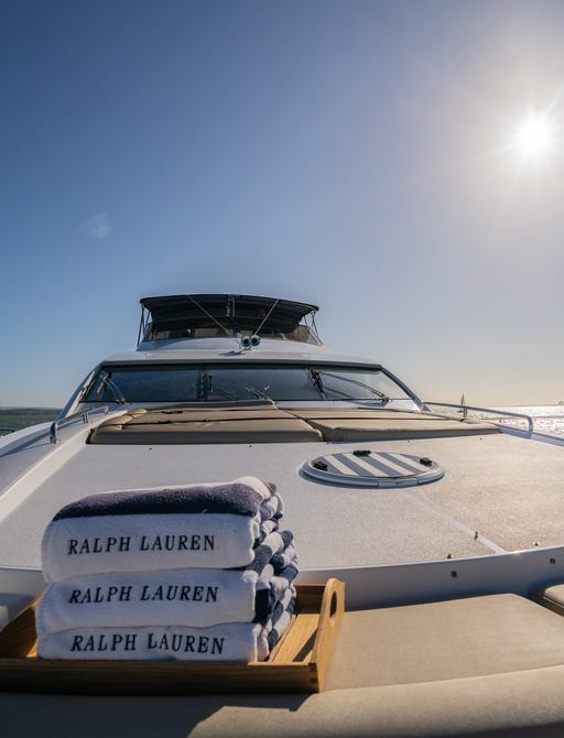 foredeck on motor yacht chess, with ralph lauren towels and sunpads