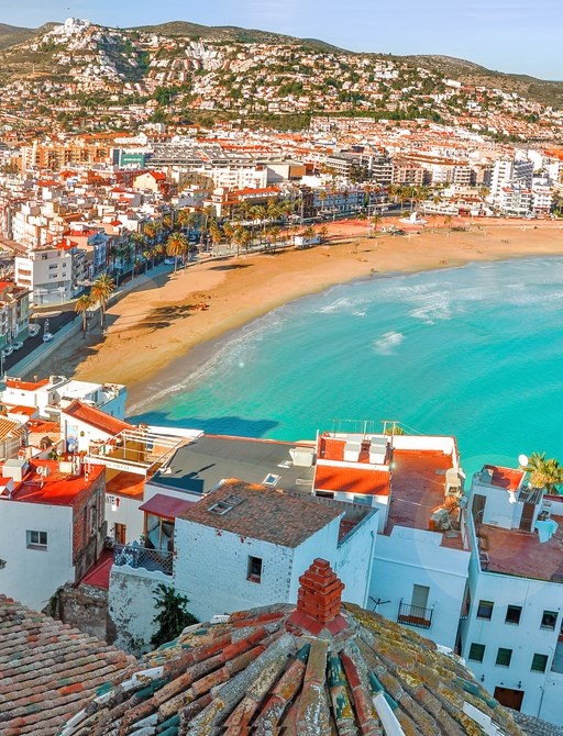 Birds eye view of town on the coast of Spain, near Valencia, with white sandy beaches and ancient architecture
