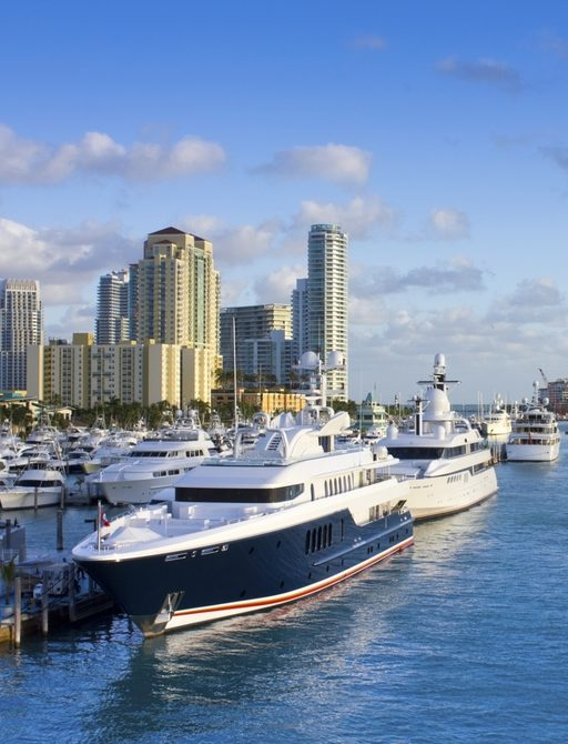 luxury yacht berthed in a harbour in Miami for Art Basel Miami