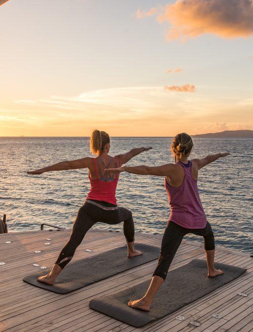Yoga session on swim platform of luxury yacht SPIRIT