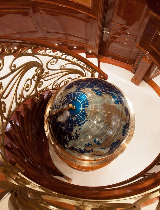 globe at base of staircase on luxury yacht st david