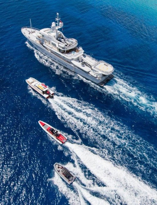 expedition yacht SENSES cruises alongside three tenders in the South Pacific