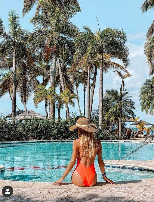 Lady at pool at Curtain Bluff resort