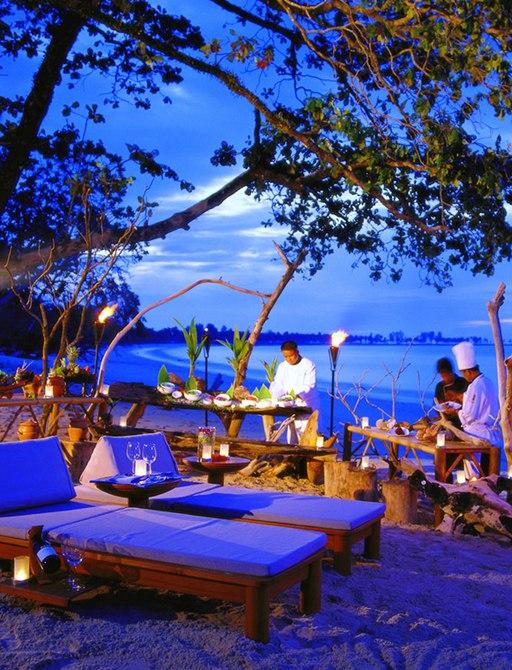 Sarojin Spa's beach and sun lounger area in Thailand