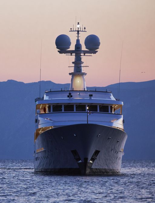 stern view of motor yacht ANCALLIA underway on a Greece yacht charter at sunset