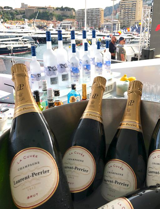 champage bottles in a large ice bucket on board a luxury yacht at the Monaco Grand Prix