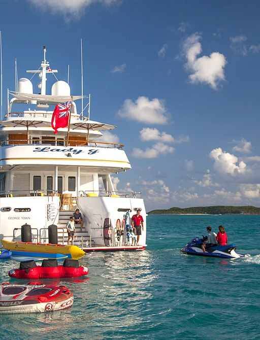 guests using the impressive collection of lucury charter yacht Lady J as it anchors on a sany shore of the Virgin Islands