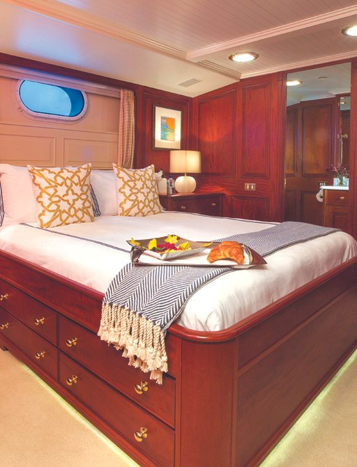 the warm and classic styled VIP suite inside superyacht Lady J