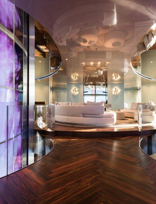 Elegant interior on superyacht SAVANNAH, with light colored sofas and wooden flooring