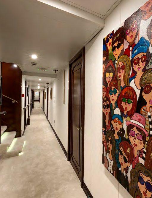 Interesting art on wall of corridor on Superyacht CHAKRA