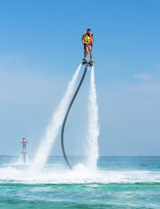 Man enjoys Flyboarding on board superyacht