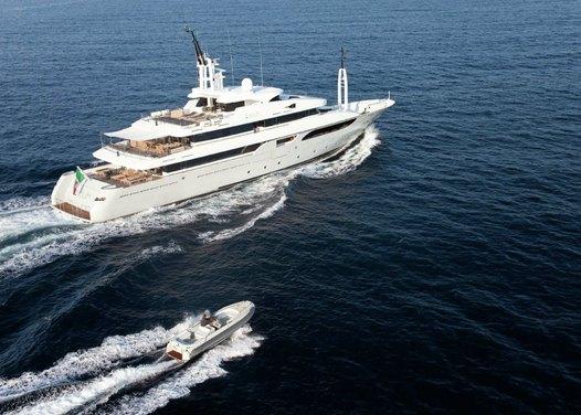 Rarity Yacht Running Shot with Tender