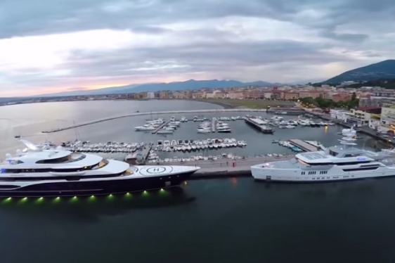 DRONE VIDEO: Superyachts SYMPHONY and 'Ester III' Tower Over Italy Harbour