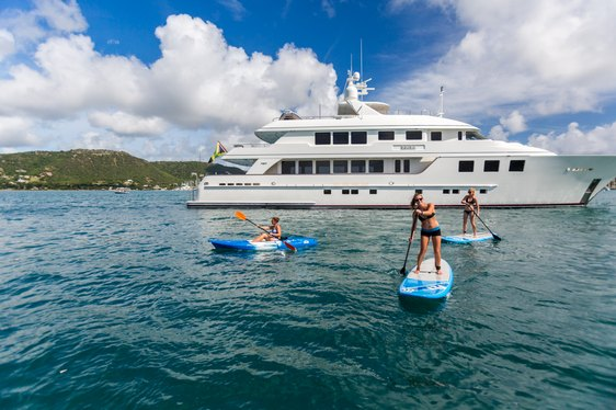 superyacht MIM anchored with charter guests enjoying water toys