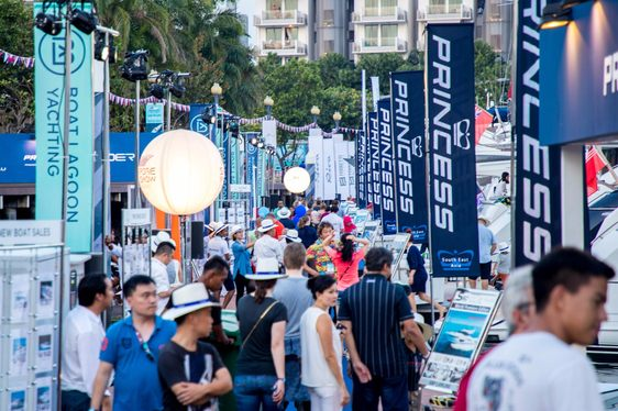 visitors tread the boardwalks along the One°15 Marina at the Singapore Yacht Show