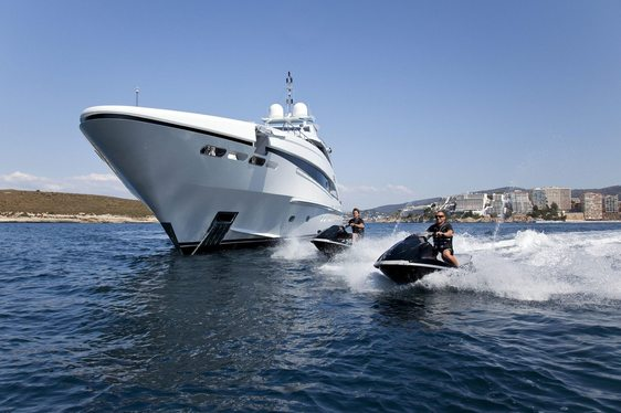 jet skis take to the water as luxury yacht JEMS anchors on a luxury yacht charter