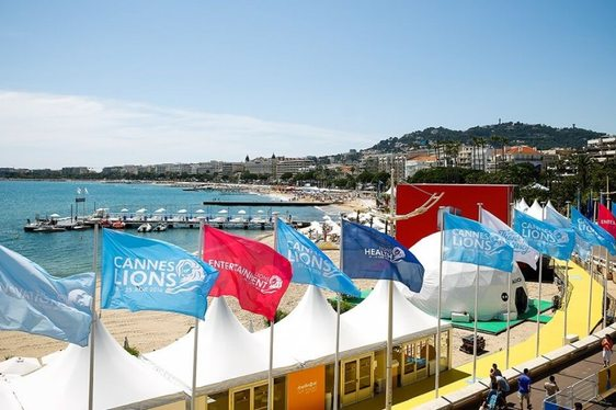 Flags advertising Cannes Lions flutter in the breeze along Cannes seafront