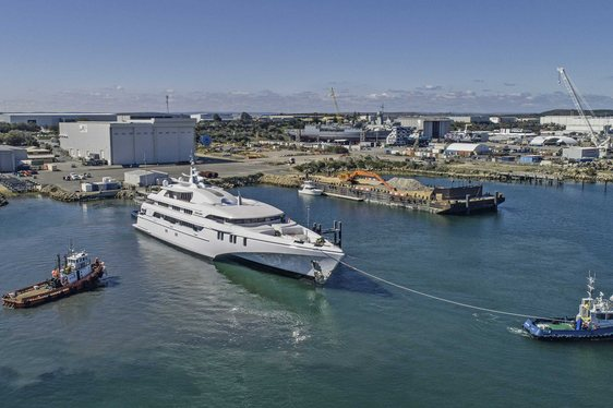 luxury tri-hulled superyacht White Rabbit launching from Echo Yachts shipyard
