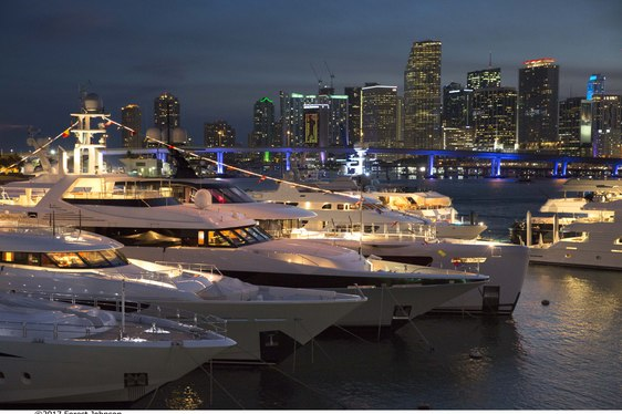 yachts line up at Watson Island at night for Superyacht Miami