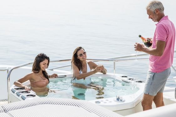 guests sip champagne in the spa pool aboard superyacht FLEUR