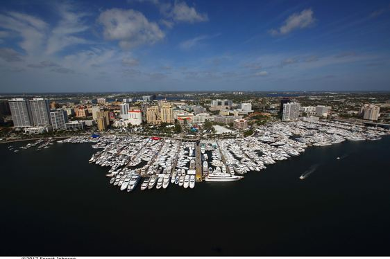 scores of luxury yachts and boats line up for the Palm Beach Boat Show in Florida