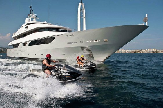 superyacht RARITY alongside jet skis on a private yacht charter in the Mediterranean