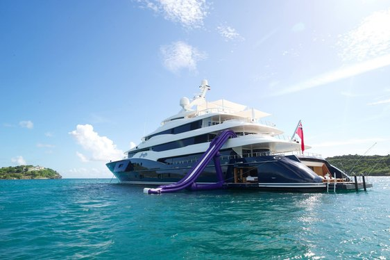 motor yacht AMARYLLIS anchored with water slide set up and swim platforms dropped down