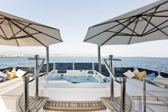Sun deck with Jacuzzi aboard charter yacht Marina Wonder