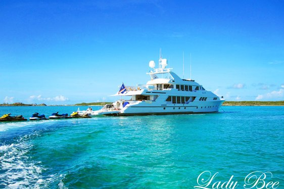 superyacht Lady Bee cruising alongside water toys