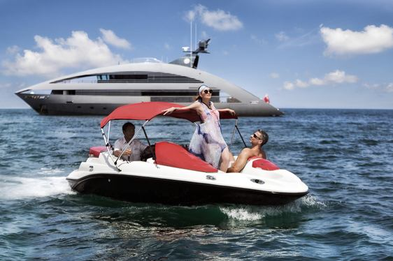 Models on a Jetski nearby to superyacht Ocean Emerald