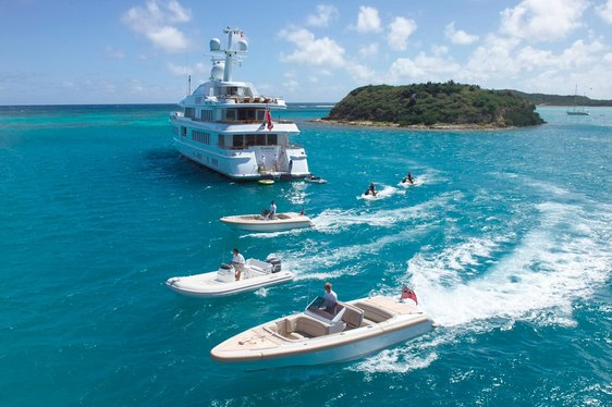luxury yacht huntress cruising with tender and water toys