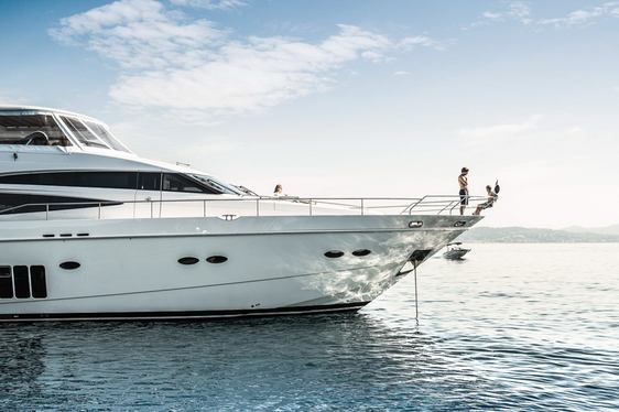 Charter guests hang out on the foredeck of luxury yacht CRISTOBAL
