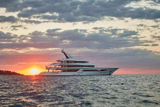 luxury yacht joy profile shot with sunset in background