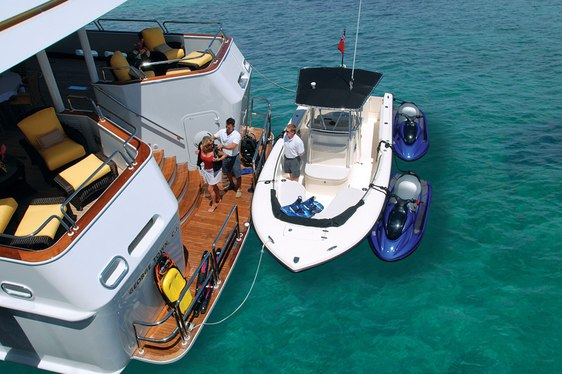 Rear view of charter yacht Lady J and her tender