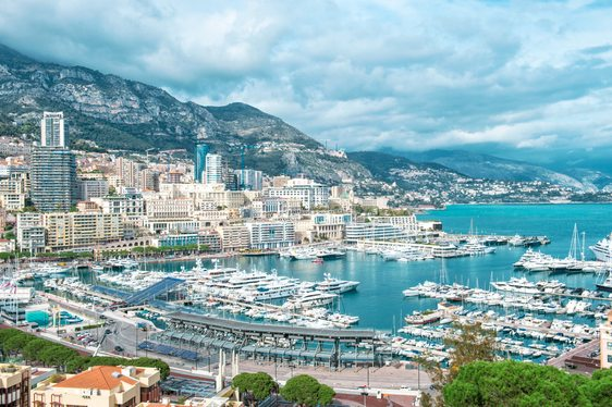 Aerial image of Monaco Grand Prix with superyachts in harbour