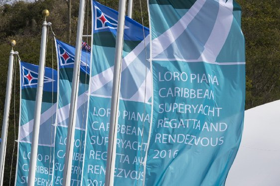 Flags waving in the wind at the Loro Piana Caribbean Superyacht Regatta and Rendezvous 2016