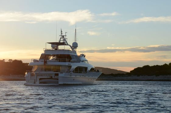 aft view of motor yacht SALU when anchored at sunset on a Mediterranean yacht charter