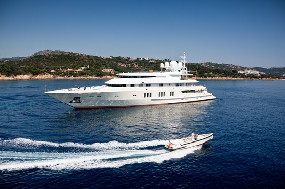 superyacht Coral Ocean anchors on a luxury yacht charter alongside matching custom-made tender
