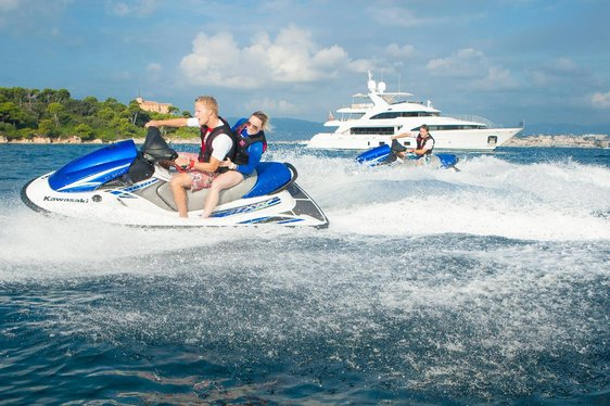 charter guests on board superyacht DYNAR take to the jet skis