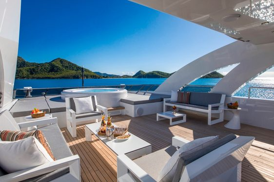 Jacuzzi and seating area on the sundeck of charter yacht G3
