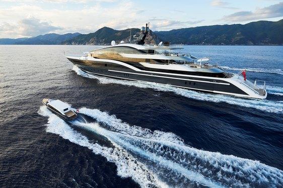 motor yacht DAR cruising alongside her matching custom tender